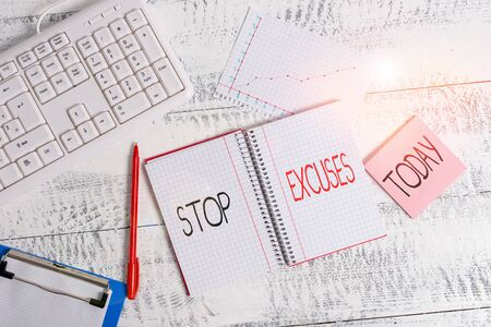 Word writing text Stop Excuses. Business photo showcasing put an end to an explanation for something that went wrong Wood desk office appliance computer equipaments chart numbers paper slot