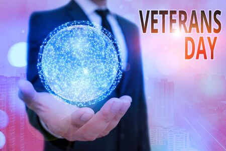 Conceptual hand writing showing Veterans Day. Concept meaning a public holiday to honour US veterans and victims of all wars Elements of this image furnished by NASA