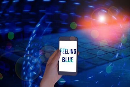 Handwriting text writing Feeling Blue. Conceptual photo Feeling of desperation because of sadness or missing someone