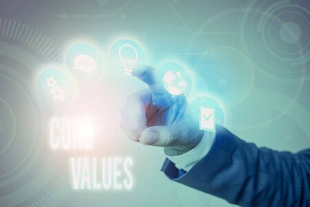 Writing note showing Core Values. Business concept for the fundamental beliefs or principle of a demonstrating or organization Banco de Imagens