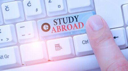 Conceptual hand writing showing Study Abroad. Concept meaning live in a foreign country and attend a foreign university Foto de archivo