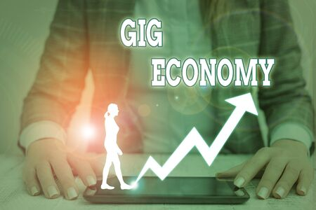 Word writing text Gig Economy. Business photo showcasing free market system in which temporary positions are common Stock Photo