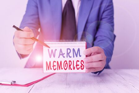 Text sign showing Warm Memories. Business photo text Something that you remember with pleasure Sweet reminiscences Man holds empty paper with copy space in front of him Copy Space