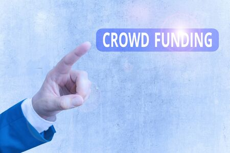 Writing note showing Crowd Funding. Business concept for technique of raising money from a large number of showing Banque d'images