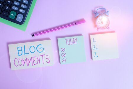 Handwriting text writing Blog Comments. Conceptual photo Space at the end of each post for a reader to leave a comment Multicolor notepads alarm clock calculator sheet marker colored background Banco de Imagens
