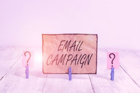 Writing note showing Email Campaign. Business concept for advertisements are sent to a targeted list of recipients Crumbling sheet with paper clips placed on the wooden table