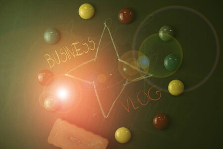 Handwriting text Business Vlog. Conceptual photo A video content about subject matter related to the company Round Flat shape stones with one eraser stick to old chalk black board