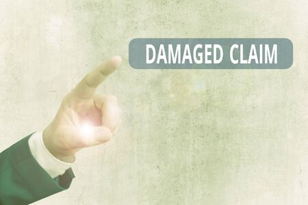 Writing note showing Damages Claim. Business concept for Demand upon the insurer for compensation for a damage Imagens