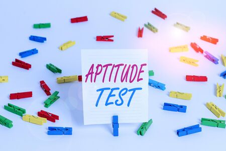 Conceptual hand writing showing Aptitude Test. Concept meaning designed to determine a demonstrating ability in a particular skill Colored clothespin papers empty reminder white floor office