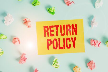 Conceptual hand writing showing Return Policy. Concept meaning return or exchange defective merchandise that they buy before Colored clothespin rectangle shaped paper blue background