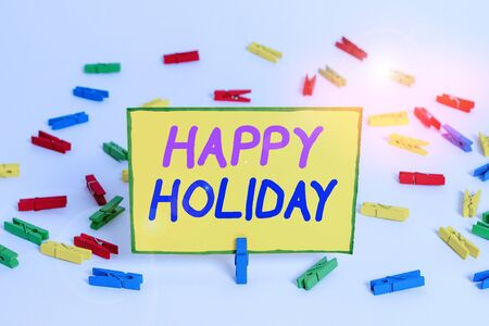 Writing note showing Happy Holiday. Business concept for a greeting or farewell before a holiday season begins Colored clothespin papers empty reminder white floor background office