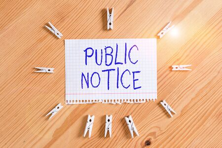 Conceptual hand writing showing Public Notice. Concept meaning Announcements widely disseminated through broadcast media Colored crumpled papers wooden floor background clothespin Standard-Bild