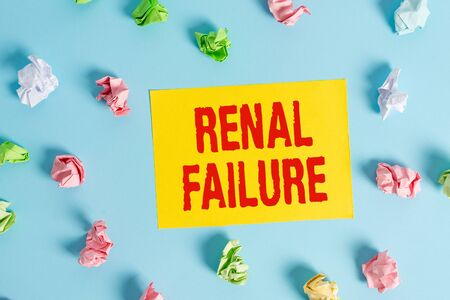 Conceptual hand writing showing Renal Failure. Concept meaning medical condition in which the kidneys no longer function Colored clothespin rectangle shaped paper blue background Standard-Bild