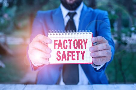 Handwriting text Factory Safety. Conceptual photo minimize risk of worker injury while doing production tasks Man holds empty paper with copy space in front of him