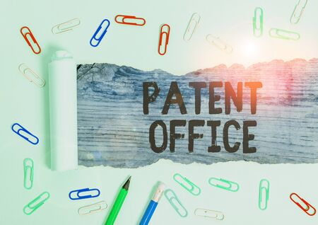 Writing note showing Patent Office. Business concept for a government office that makes decisions about giving patents