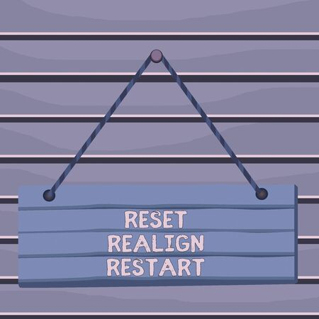 Conceptual hand writing showing Reset Realign Restart. Concept meaning Life audit will help you put things in perspectives Wood plank nail pin colorful background wooden panel fixed Stock Photo