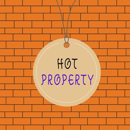 Text sign showing Hot Property. Business photo text one that many showing want to buy and it is highly desirable Badge circle label string rounded empty tag colorful background small shape