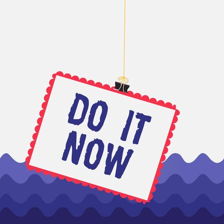 Conceptual hand writing showing Do It Now. Concept meaning not hesitate and start working or doing stuff right away Stamp stuck binder clip square color frame rounded tip 版權商用圖片