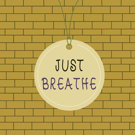 Text sign showing Just Breathe. Business photo text Take a break in a stressful day To overcome difficulties Relax Badge circle label string rounded empty tag colorful background small shape