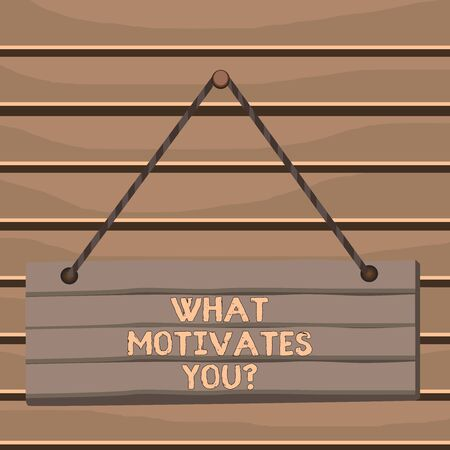 Conceptual hand writing showing What Motivates Youquestion. Concept meaning know reasons why you want to wake up each morning Wood plank nail pin colorful background wooden panel fixed Standard-Bild
