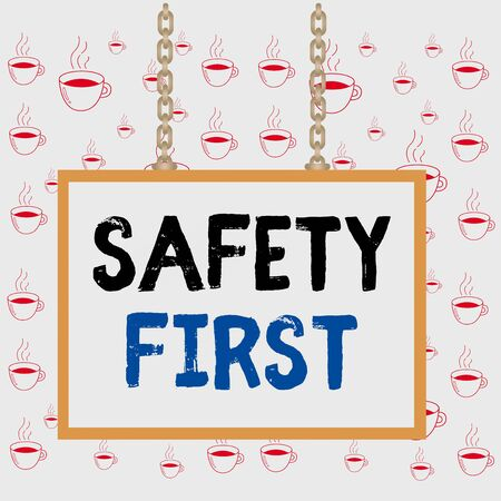 Writing note showing Safety First. Business concept for used to say that the most important thing is to be safe Whiteboard rectangle frame attached surface chain panel
