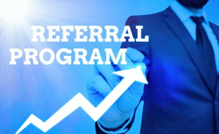 Writing note showing Referral Program. Business concept for internal recruitment method employed by organizations