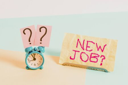 Conceptual hand writing showing New Job Question. Concept meaning formal meeting which someone asked find out if they are suitable Alarm clock beside a Paper sheet placed on pastel backdrop