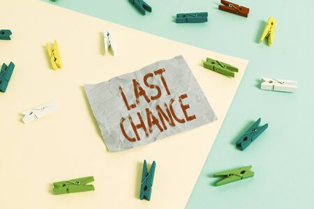 Text sign showing Last Chance. Business photo showcasing final opportunity to achieve or acquire something you want Colored clothespin paper empty reminder yellow blue floor background office