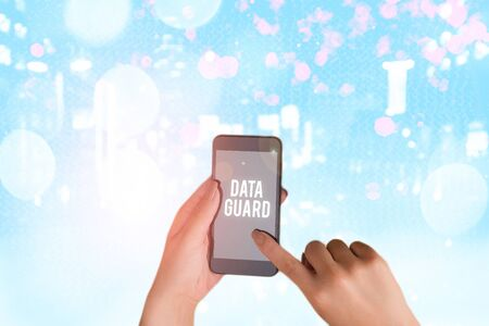 Conceptual hand writing showing Data Guard. Concept meaning manage databases to survive disasters and data corruptions Foto de archivo