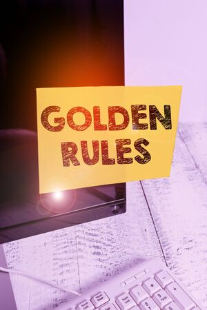 Word writing text Golden Rules. Business photo showcasing basic principle that should always follow to ensure success Notation paper taped to black computer monitor screen near white keyboard