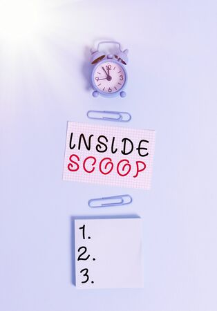 Text sign showing Inside Scoop. Business photo text Information that only an insider would have Real information Alarm clock squared blank paper sheet notepad clips colored background Standard-Bild