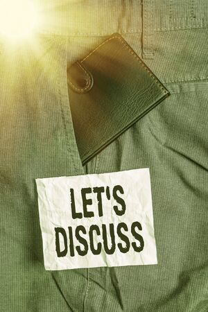 Text sign showing Lets Discuss. Business photo showcasing asking someone to talk about something with demonstrating or showing Small little wallet inside man trousers front pocket near notation paper