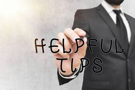 Writing note showing Helpful Tips. Business concept for advices given to be helpful knowledge in life Imagens