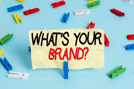 Text sign showing Whats Your Brand Question. Business photo showcasing asking about product logo does or what you communicate Colored clothespin papers empty reminder blue floor background office pin