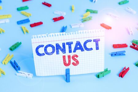 Writing note showing Contact Us. Business concept for Term used to describe reaching out with the business or demonstrating Colored clothespin papers empty reminder blue floor officepin 写真素材