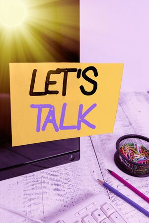 Text sign showing Lets Is Talk. Business photo text suggesting in the beginning of a conversation on the topic Note paper taped to black computer screen near keyboard and stationary
