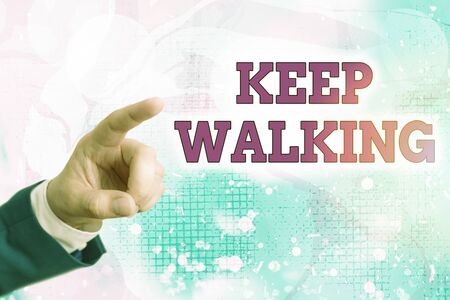Writing note showing Keep Walking. Business concept for continuing on exactly as we started Abounding in thanksgiving Standard-Bild
