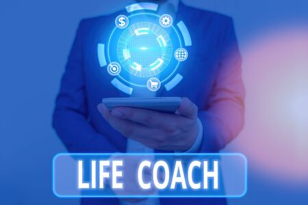 Writing note showing Life Coach. Business concept for someone who helps identify your goals and plan to achieve them Imagens