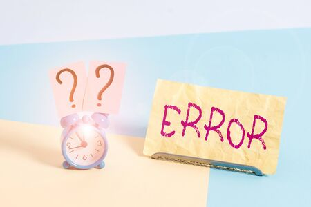 Conceptual hand writing showing Error. Concept meaning state or condition of being wrong in conduct judgement or program Alarm clock beside a Paper sheet placed on pastel backdrop