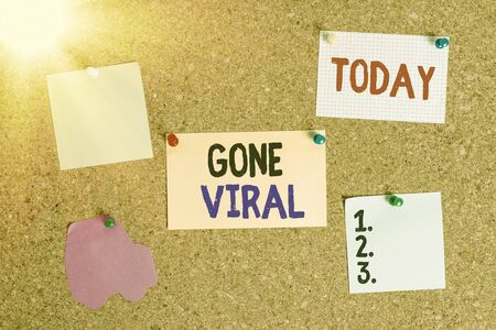 Conceptual hand writing showing Gone Viral. Concept meaning link that spreads rapidly through a population by sharing Corkboard size paper thumbtack sheet billboard notice board 写真素材