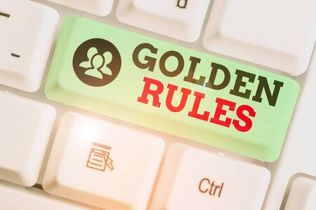 Conceptual hand writing showing Golden Rules. Concept meaning basic principle that should always follow to ensure success Standard-Bild