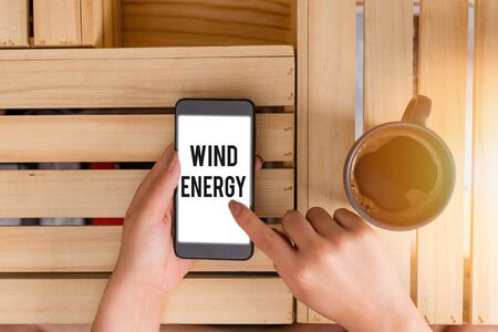 Handwriting text Wind Energy. Conceptual photo the process by which wind is used to generate electricity Banco de Imagens