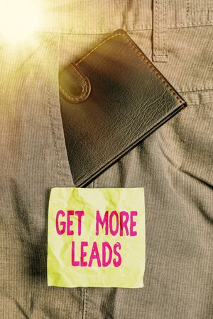 Conceptual hand writing showing Get More Leads. Concept meaning initiation consumer interest or enquiry products or services Small wallet inside trouser front pocket near notation paper Stock Photo