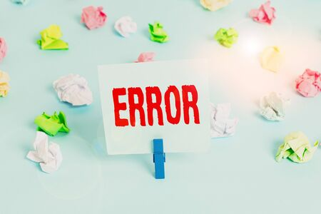 Text sign showing Error. Business photo showcasing state or condition of being wrong in conduct judgement or program Colored crumpled papers empty reminder blue floor background clothespin