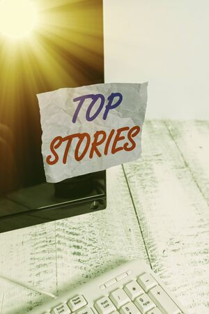 Conceptual hand writing showing Top Stories. Concept meaning a major story running on the front page of a newspaper Notation paper computer monitor screen near white keyboard