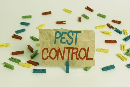 Text sign showing Pest Control. Business photo text management of a species that impacts adversely on human Colored clothespin papers empty reminder white floor background office