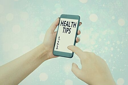 Writing note showing Health Tips. Business concept for advice or information given to be helpful in being healthy