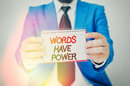 Writing note showing Words Have Power. Business concept for as they has ability to help heal hurt or harm someone Man holds empty paper with copy space in front of him Space
