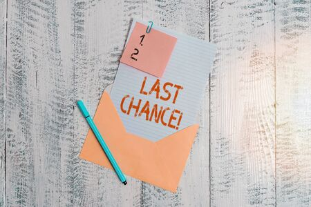 Text sign showing Last Chance. Business photo text final opportunity to achieve or acquire something you want Envelope blank sheet letter paper sticky note ballpoint wooden background 版權商用圖片
