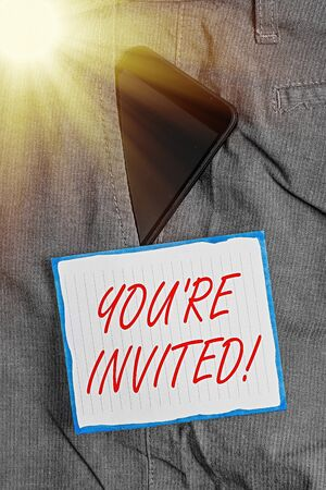 Conceptual hand writing showing You are Invited. Concept meaning make a polite friendly request to someone go somewhere Smartphone device inside trousers front pocket note paper